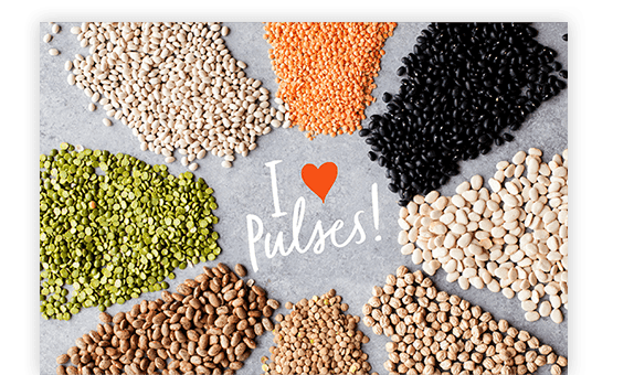 Piles of pulses surrounding 'I Love Pulses' text